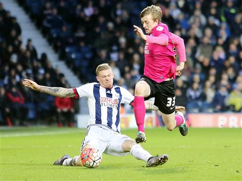 Chris Forrester skips past an angry James McLean of WBA