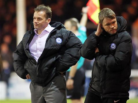 Graham Westley and Grant McCann frustrated by the Posh performance v Burton