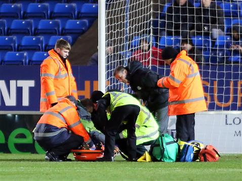 Harry Toffolo being strapped into the stretcher v Burton