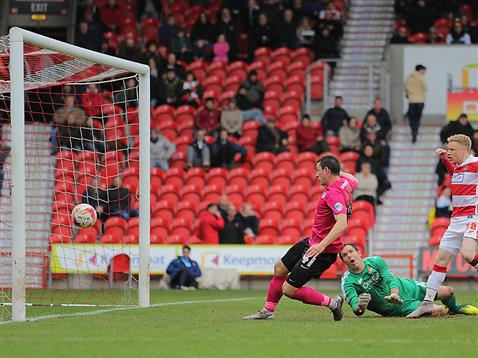 Aaron Williams taps in for the equaliser v Doncaster