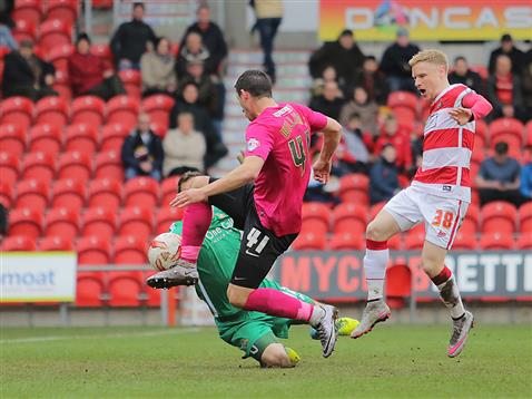 Aaron Williams thwarted again by the Doncaster goalkeeper and Craig Alcock
