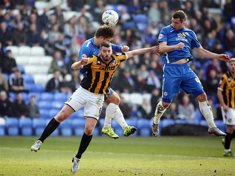 Aerial battle with Tom Nicholls and Aaron Williams v Port Vale
