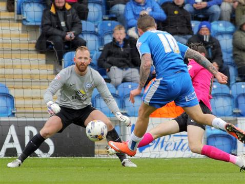 Ben Alnwick concentrates as Jack Baldwin blocks a Colchester effort