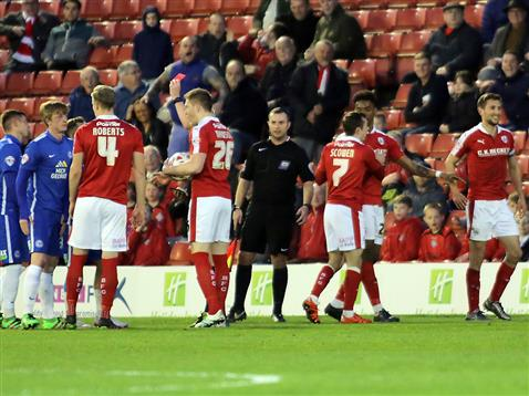 Chris Forrester receives a red following a clash with Barnsley Hourihane