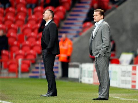 Darren Ferguson looking to the goads as Graham Westley watches Posh v Doncaster