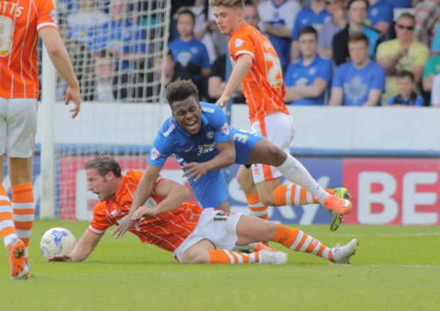 Former Posh loanee David Norris brings down Shq Coulthirst for a penalty v Blackpool
