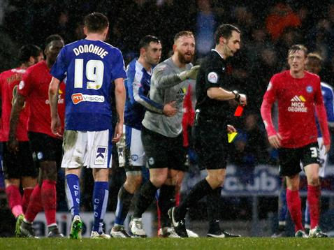 Goalkeeper Ben Alnwick argues with referee David Coote after he send Almeida Santos off v Chesterfield