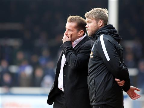 Graham Westley and Grant McCann during the defeat to Swindon