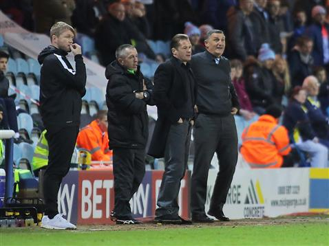 Graham Westley and Grant McCann stood on the touchline with Coventry boss Tony Mowbray