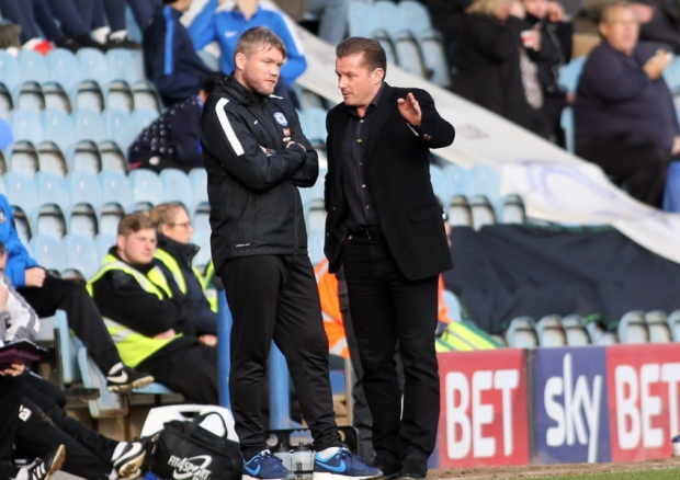 Graham Westley trying to convince Grant McCann on his bewildering transfers v Port Vale