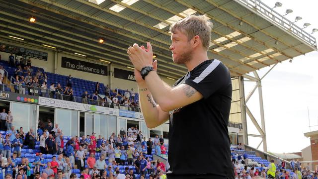 Grant McCann claps fans after Blackpool win