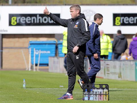 Grant McCann gives his thumbs up to his players after seeing them take the lead against the run of play v Shrewsbury