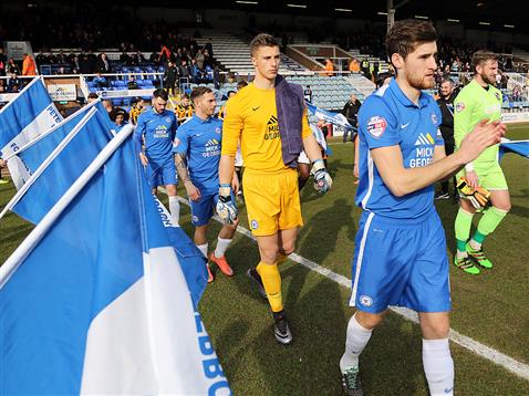 Jack Baldwin leads out Posh followed by Reading loanne keeper Stuart Moore v Port Vale