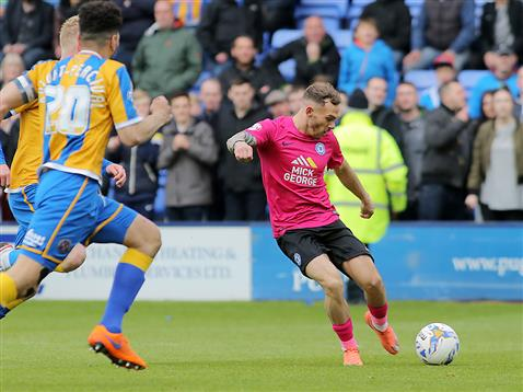 Jon Taylor fires in the winner in the 94th minute v Shrewsbury