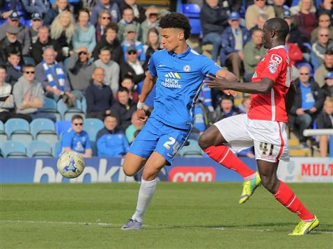 Lee Angol about to strike a sweet shot for goal 3 v Crewe