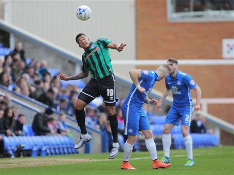 Marcus Maddison and Michael Smioth watch Rochdales Nathaniel Mendez-Laing head the ball