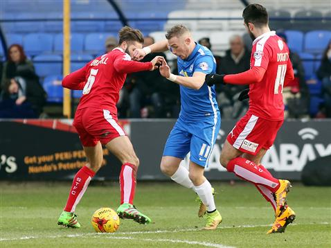 Marcus Maddison burst between two Swindon players