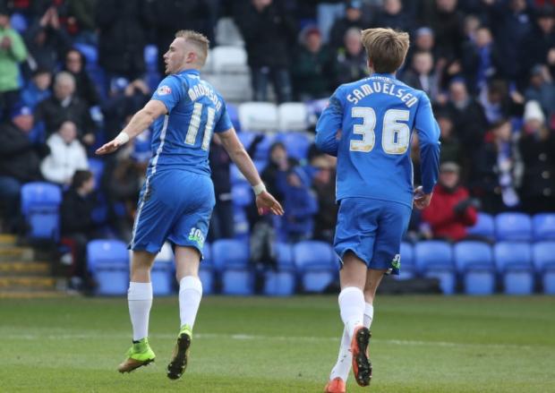 Marcus Maddison celebrates his penalty v Swindon