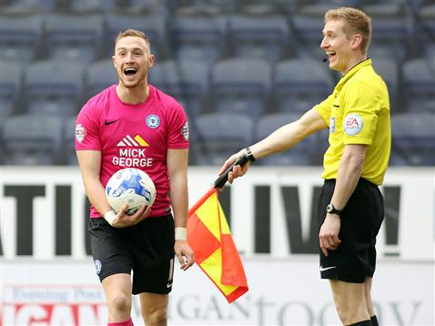 Marcus Maddison enjoying a laugh with the linesman v Wigan