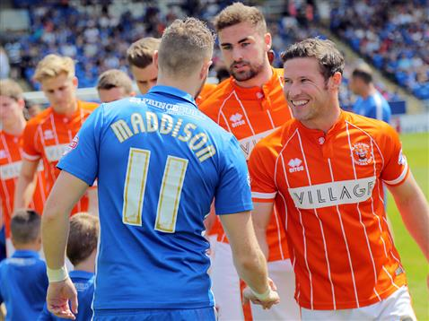 Marcus Maddison shakes hands with former Posh loanee and Jack Hunt schoolboy David Norris