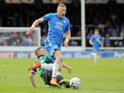 Marcus Maddison tackled from behind by Rochdale
