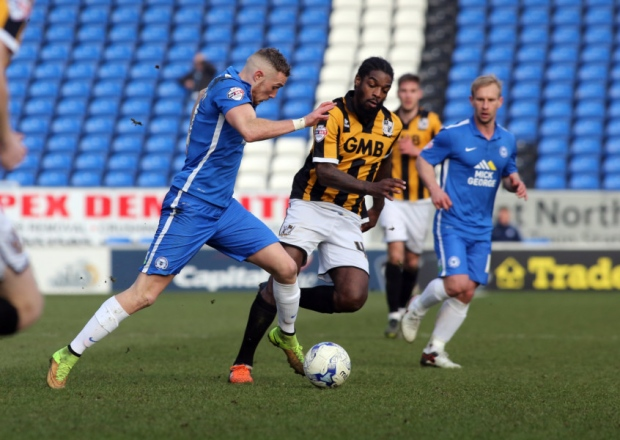 Marcus Maddison watched by Simon Gillett v Port Vale