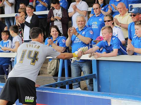Mark Tyler gives his gloves to Posh fan after final game of season v Blackpool