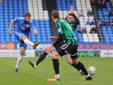 Michael Bostwick blasts an effort v Rochdale