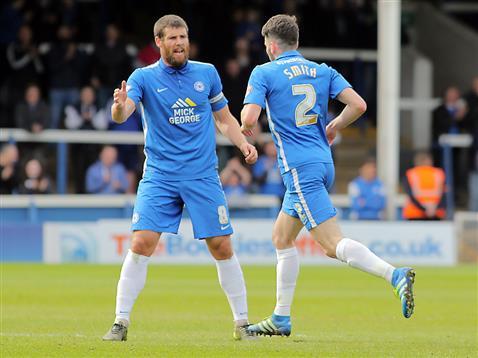 Michael Bostwick congratulates Michael Smith on his goal v Rochdale