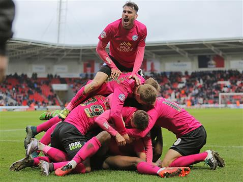 Michael Smith on top of the player bundle after a 93rd minute winner v Doncaster