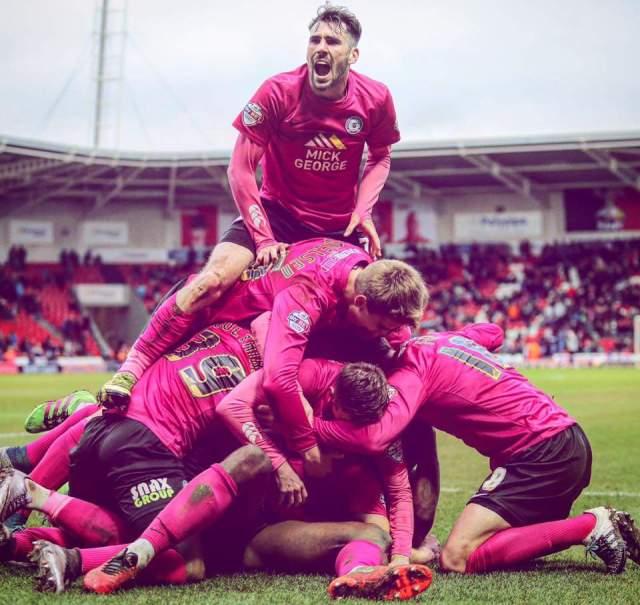 Posh players celebrate the winner v Doncaster