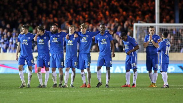 Posh players during penalty shoot out defeat by WBA