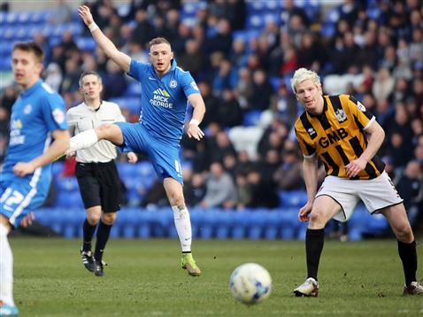 Referee Darren Bond watches Marcus Maddison shoot v Port Vale