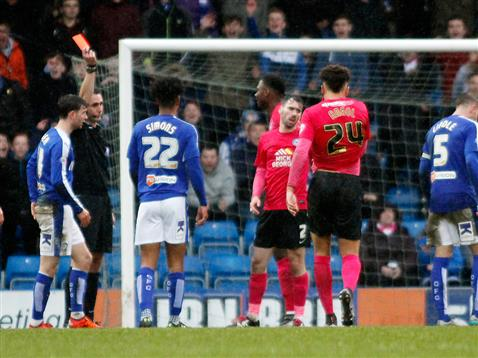 Referee David Coote shows Michael Smith the red card v Chesterfield