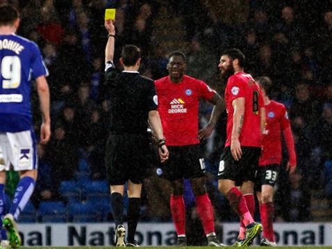 Referee David Coote shows Ricardo Almeida Santos a second yellow card v Chesterfield