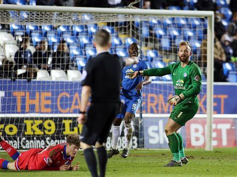 Referee David Webb awards a penalty to Oldham