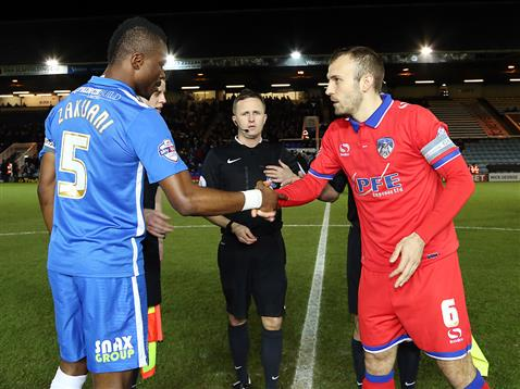 Referee David Webb watches the handshake between Gaby Zakuani and the Oldham captain