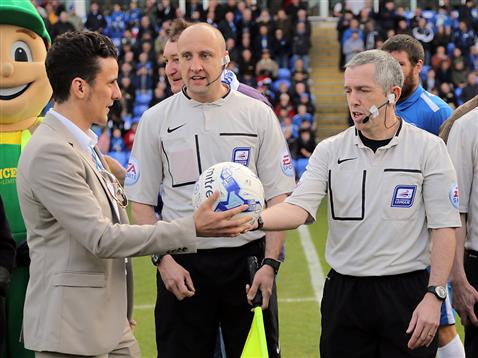 Referee Fred Graham handed the matchball ahead of the Posh v Rochdale match