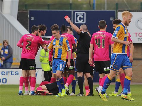 Referee Graham Salisbury sends off Shrewsburys Ian Black for a second yellow card