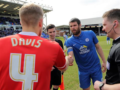 Referee Lee Collins watches Michael Bostwick shake the Crewe captains hand