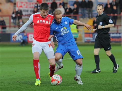 Referee Peter Bankes watches Marcus Maddison v Fleetwood