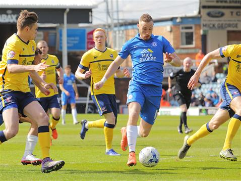 Referee Phil Gibbs watches Marcus Maddison surrounded by Scunthorpe players