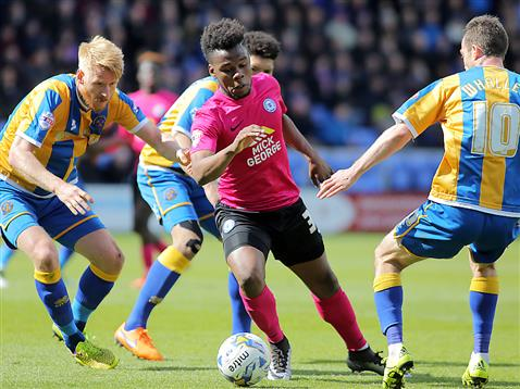 Shaq Coulthirst gets the better of 3 Shrewsbury defenders