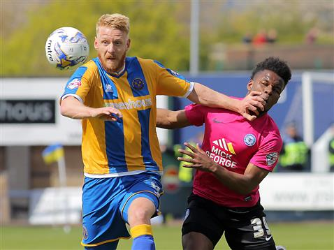 Shaq Coulthirst held off by Shrewsbury defender