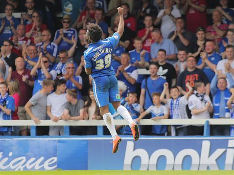 Shaq Coulthirst jumps for joy after scoring v Blackpool
