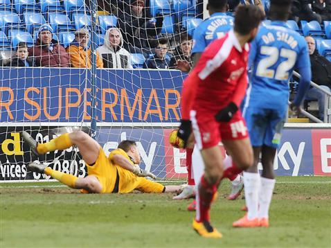 Stuart Moore cant keep the ball out v Swindon