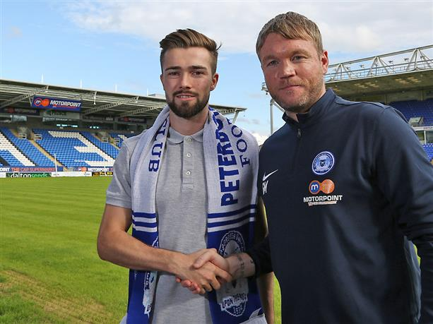Gwion Edwards with Grant McCann after signing a 3-year deal at Posh