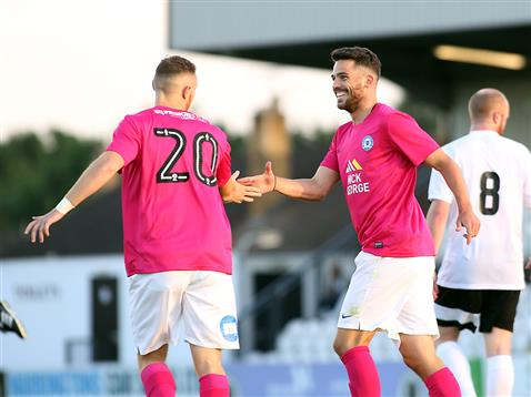 Brad Inman congratulates Marcus Maddison on his penalty v Boreham Wood