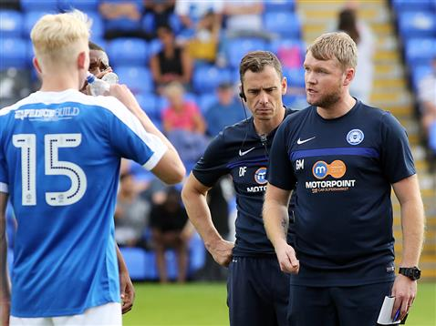 16-year-old Lewis Freestone with Grant McCann and David Farrell after the defeat to Norwich