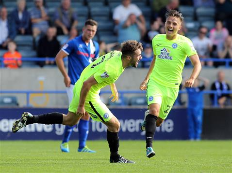 Gwion Edwards and Tom Nichols celebrate the 89th minute winner v Rochdale